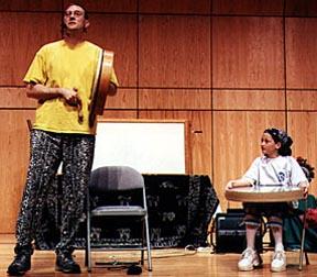 """Mark Shepard sings """"The Silkie"""" w help of young audience volunteer"""