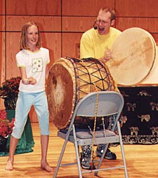 DrumSongStory at CT Storytelling Festival w/ young audience volunteer