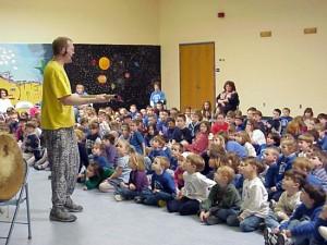 Elementary school children transfixed by a DrumSongStory program